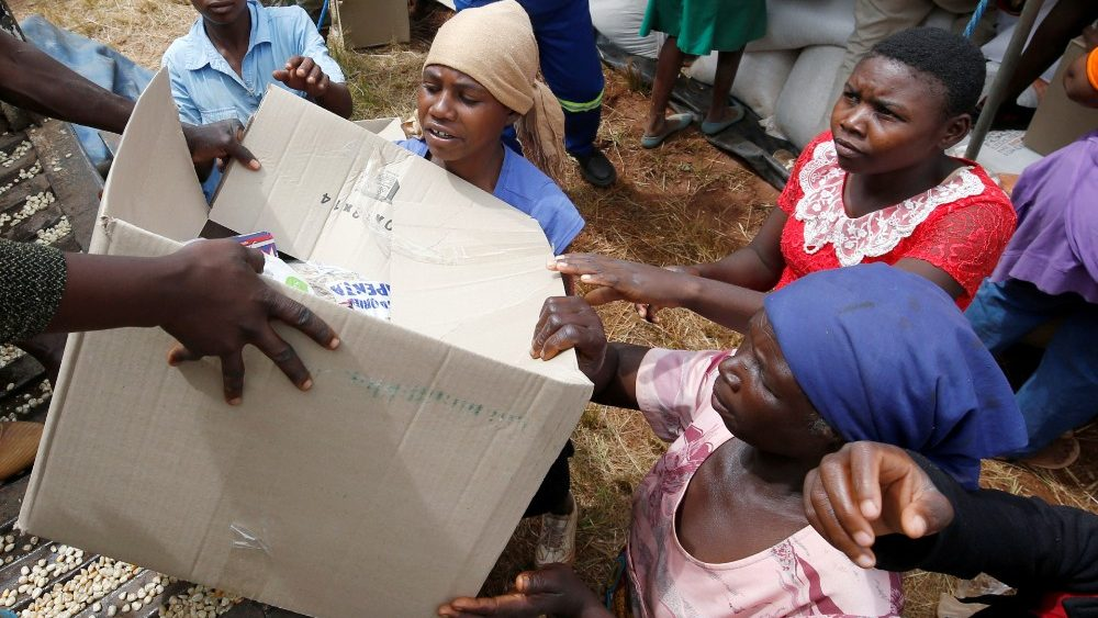 file-photo--victims-of-cyclone-idai-receive-f-1554470634673.JPG