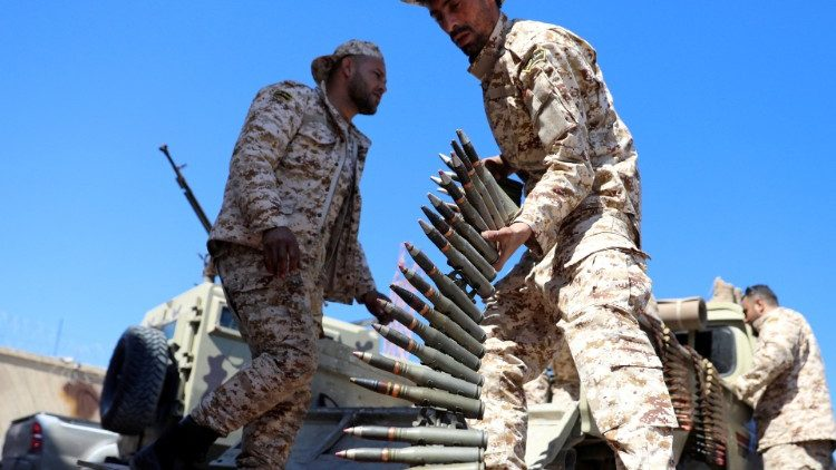 Forces loyal to the UN-backed government prepare to deploy to the front line in Tripoli