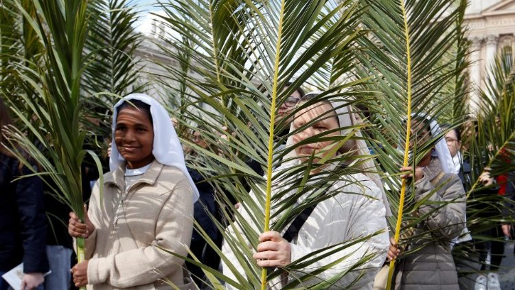 nuns-hold-palm-branches-at-the-start-of-the-p-1555230242964.JPG