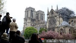 people-take-pictures-of-notre-dame-cathedral--1555417453649.JPG