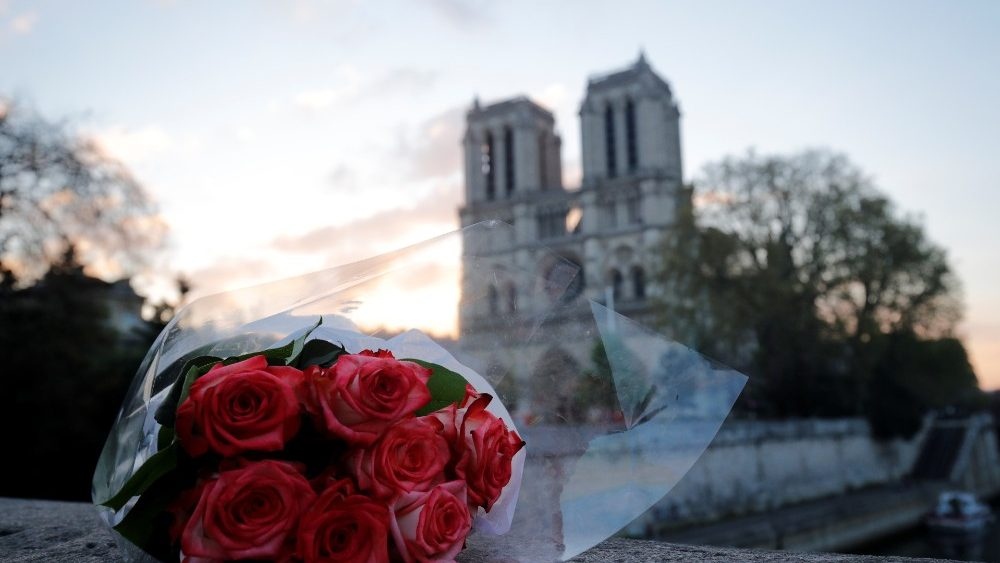 a-bunch-of-roses-placed-near-notre-dame-cathe-1555486477752.JPG