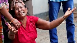 A relative of a victim of the explosion at St. Anthony's Shrine, Kochchikade church, reacts at the police mortuary in Colombo