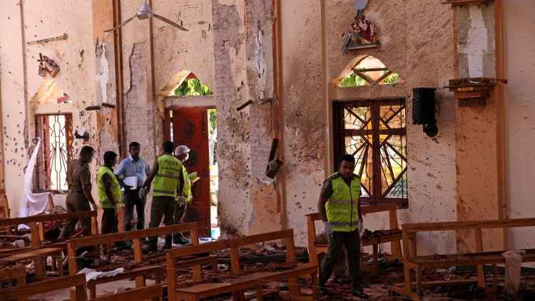 Police officers work at the scene at St. Sebastian Catholic Church in Negombo