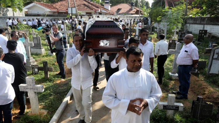 a-coffin-of-a-victim-is-carried-during-a-mass-1556015349866.JPG