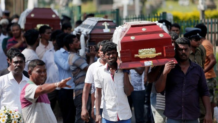 Sri Lankans began burying thier dead on April 23, following terrorist bombings in 3 churches and 3 hotels on Easter Sunday.