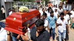 Friends and relatives carry the coffins of eight-month-old Mathew and his grandmother Agnes Vnikpridha, 69, who died during a string of suicide bomb attacks on churches and luxury hotels on Easter Sunday, at their funeral in Negombo