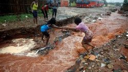 a-woman-crosses-a-flooded-street-in-the-after-1556451304839.JPG