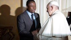 Togolese President Faure Essozimna Gnassingbe shakes hands with Pope Francis during a private audience at the Vatican.