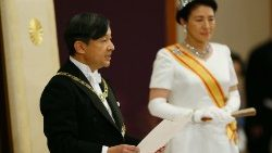 Japan's Emperor Naruhito, flanked by Empress Masako, delivers  his first speech as head of state.