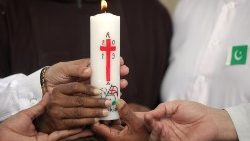 people-of-various-religions-hold-a-candle-for-1557393540644.JPG
