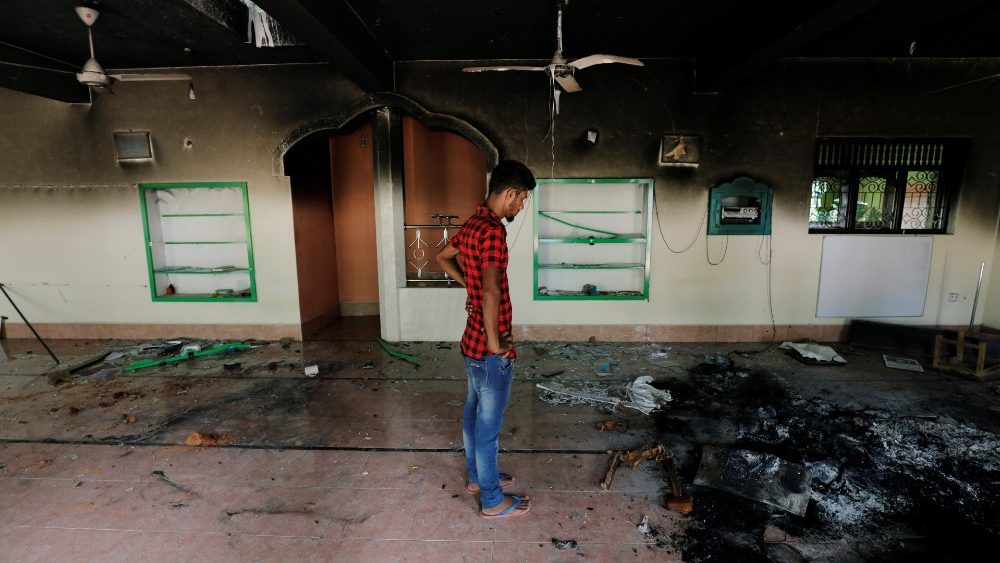 a-muslim-man-looks-at-damages-inside-a-mosque-1557849542049.JPG