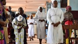(File photo) Catholics attend Mass in Kaya, Burkina Faso, near where Sunday's attack took place