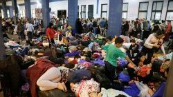 Venezuelan migrants wait at the Binational Border Service Centre of Peru