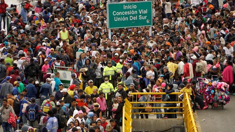 Venezuelan migrants gather to cross into Ecuador from Colombia, most of them trying to reach Peru