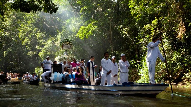 Catholic pilgrims travel as they accompany the statue of Our Lady of Conception during an annual river procession and pilgrimage along the Caraparu River in Santa Izabel do Para