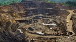Excavators and drillers at work in an open pit at a copper and cobalt mine in Congo's copper-producing south