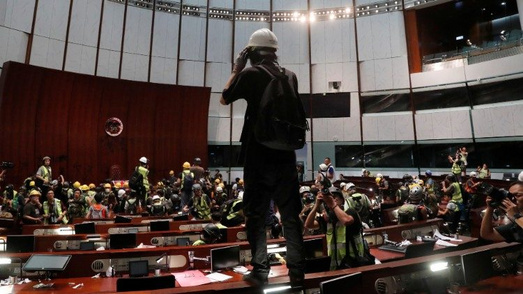 Protesters are seen inside a chamber after they broke into the Legislative Council building during the anniversary of Hong Kong's handover to China in Hong Kong