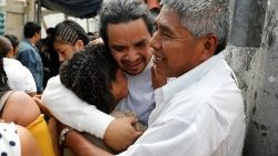 A Guatemalan migrant is embraced by his relatives  in Guatemala City upon his arrival from the United States