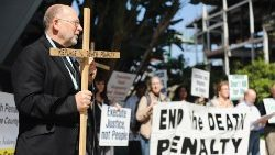 A priest speaking at a rally against the death penalty (file photo)