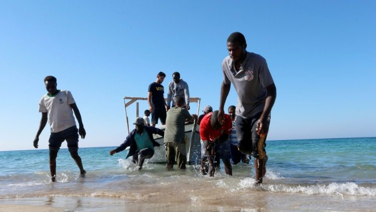 Migrants are seen after being rescued by Libyan coast guard in Tripoli