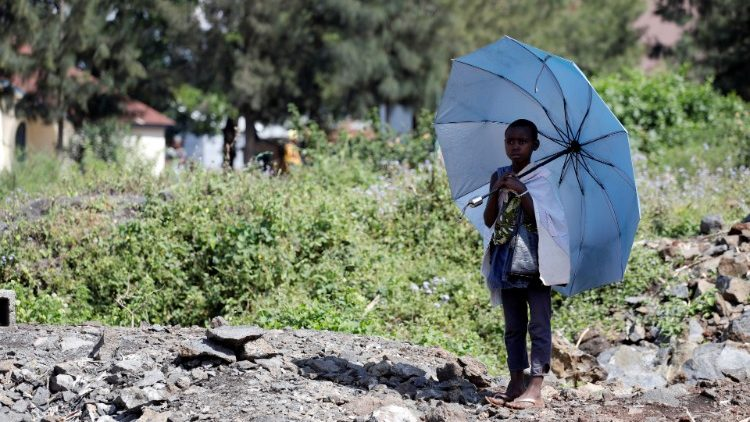 A girl stands alone near an Ebola treatment clinic in Goma, DRC
