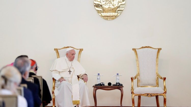 Pope Francis sits during a meeting with authorities, leaders of civil society and the diplomatic corps