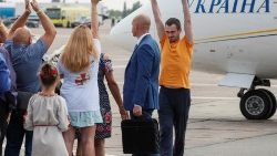 A recently exchanged Ukrainian prisoner is greeted upon arrival in Kiev