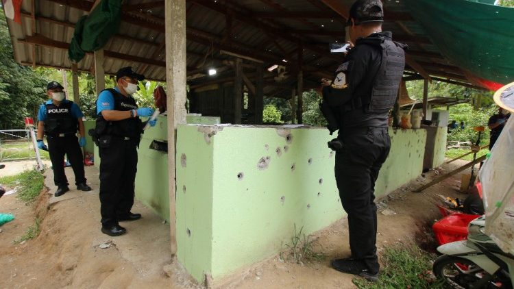 Thai forensic experts and military personnel examine the site where village defence volunteers were killed by suspected separatist insurgents in Yala province