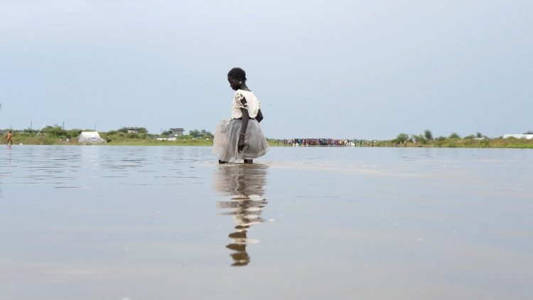 A girl walks in water, in the town of Pibor, Boma state