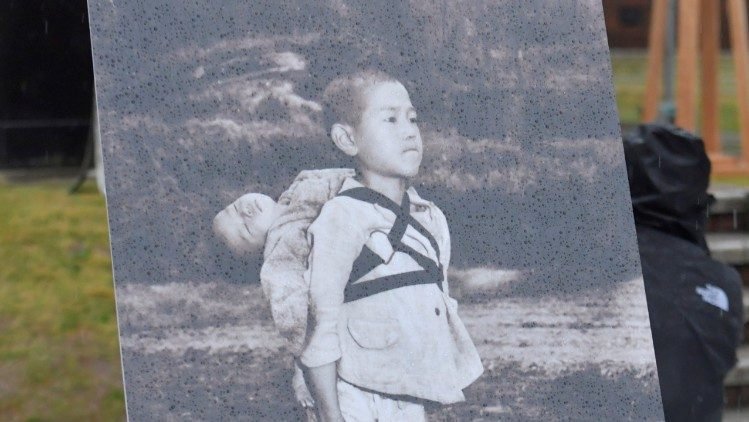 Photo of a boy carrying his dead brother on his back after atomic bombing of Nagasaki