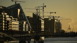 FILE PHOTO: Construction cranes are seen at sunrise in the financial district of Dublin