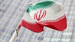 The Iranian flag flutters in front the International Atomic Energy Agency headquarters in Vienna