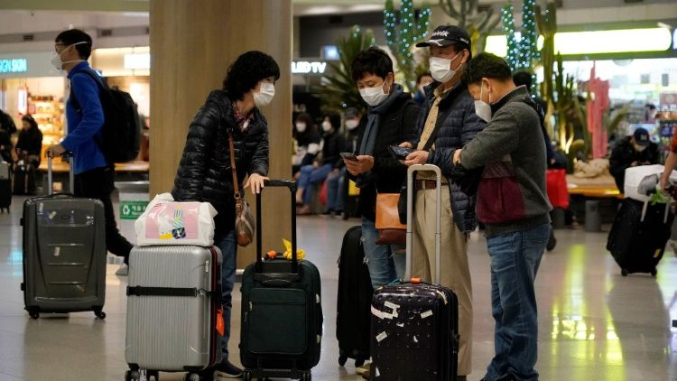 People wearing masks to prevent contracting coronavirus are seen at Incheon International Airport in Incheon