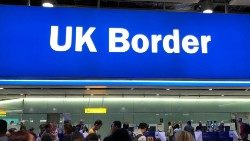 FILE PHOTO: Signage is seen at the UK border control point at the arrivals area of Heathrow Airport, London