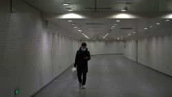 Man wearing a face mask walks in a subway station, following an outbreak of the novel coronavirus, in Beijing