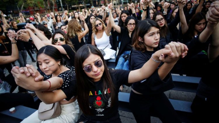 Women protest against gender violence and femicides at Angel de la Independencia monument in Mexico City