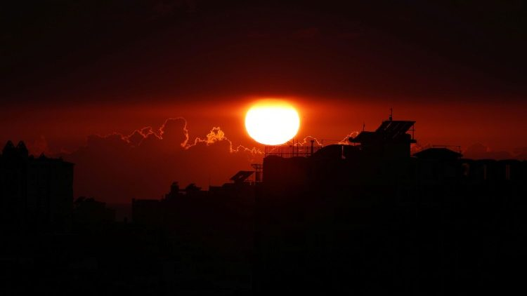 The sun sets as violence flares up between Palestinian militants and Israeli forces over the Gaza border, in Gaza City