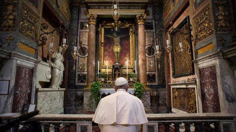 Pope Francis prays before the crucifix in St Marcelo church on the Via del Corso, Rome