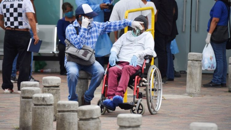 A man has his respirator mask adjusted outside Guasmo Sur General Hospital after Ecuador reported new cases of coronavirus disease (COVID-19), in Guayaquil
