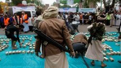 Houthi supporters carry weapons during a gathering in Sanaa