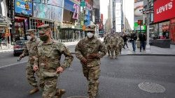 New York State Army National Guard soldiers walk through Times Square, during the outbreak of the coronavirus disease (COVID-19) in New York