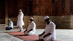 Muslim men wearing masks in prayer in Delhi, India