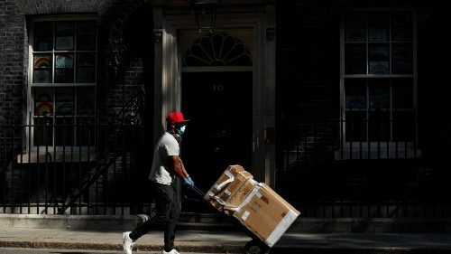 A worker making a delivery amid the Covid-19 pandemic in London