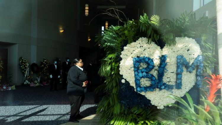 Mourners attend the funeral for George Floyd in Houston