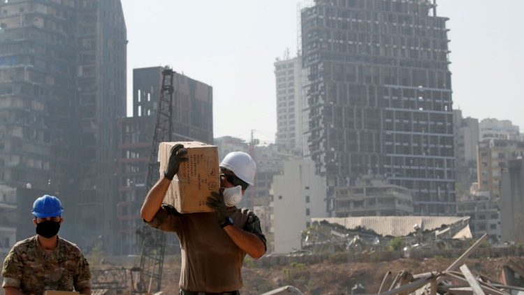 FILE PHOTO: A member of the French military works at the damaged site of the massive blast in Beirut's port area, in Beirut