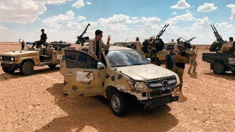 Troops loyal to Libya's internationally recognized government patrol the area in Zamzam