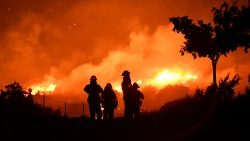 Wildfire in California burns through the night north of Los Angeles