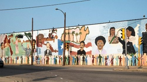 Mural showing Mexican, Puerto Rican, Native American and Black historic icons near Walker Square in Milwaukee