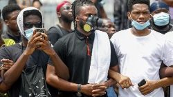 Demonstrators wearing protective masks take part in a protest over police brutality, in Lagos