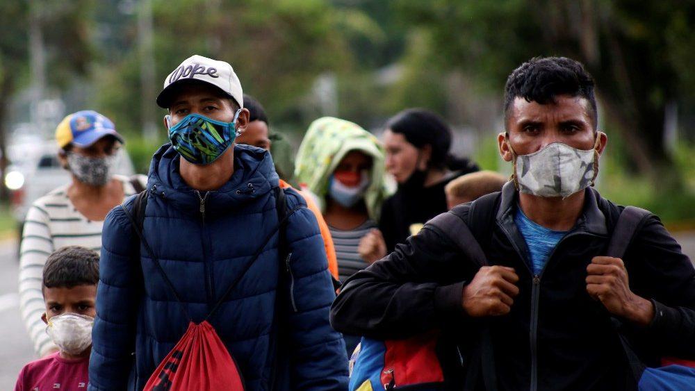 Venezuelan migrants walk towards the border between Venezuela and Colombia during the coronavirus disease (COVID-19) outbreak, in San Cristobal
